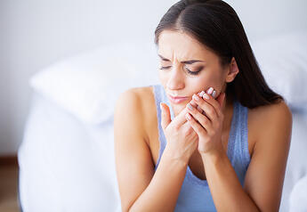tooth pain woman holding mouth