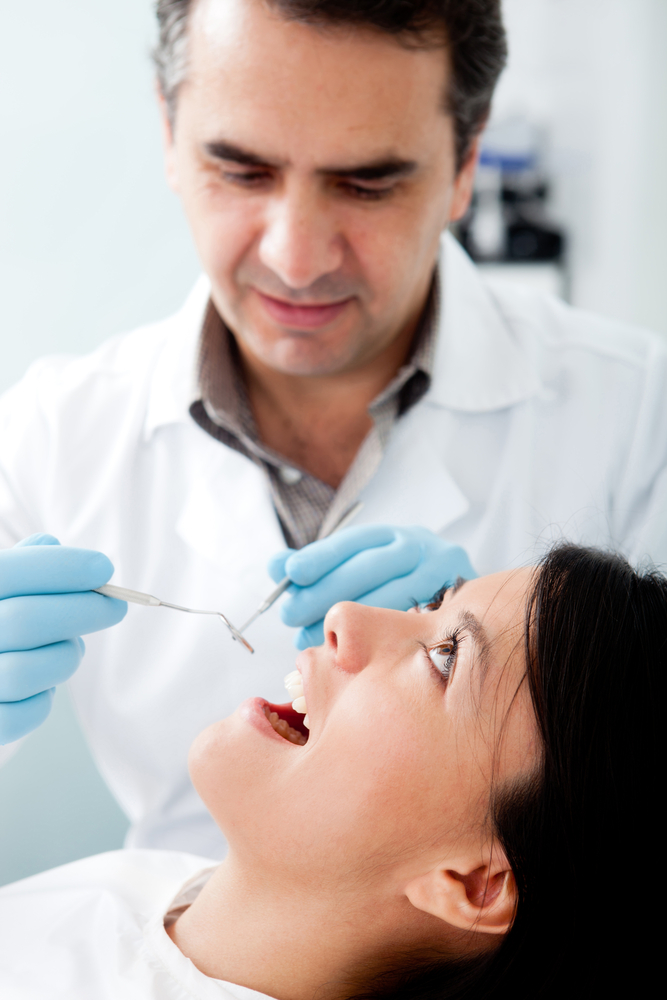 Woman visiting the dentist for cleaning and checkup
